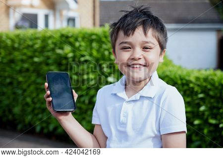 Cute Boy Showing His Photo On Mobile Phone,child Using Camera On Smart Phone Selfie Him Self,school