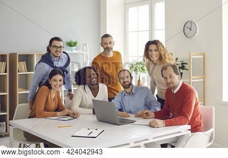 Happy Diverse Group Of People Working In Office Together Portrait