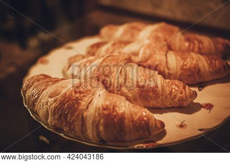 Freshly Baked Croissant On A Plate. French Food.