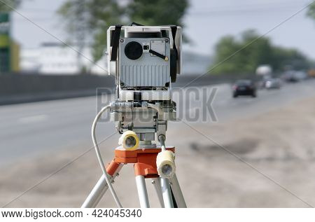 Traffic Speed Control Camera Radar Installed By Side Of The Road. Video Camera Is Recording Violatio