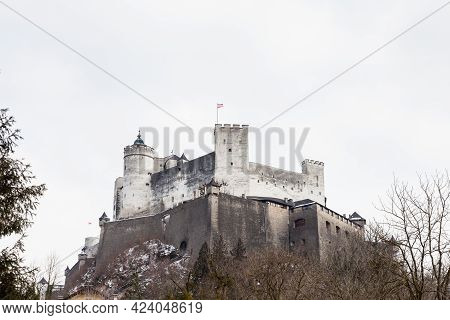 A Close Up Mid Winter View Of Hohensalzburg Fortress, Salzburg, Austria.  The Fortress Sits Atop The