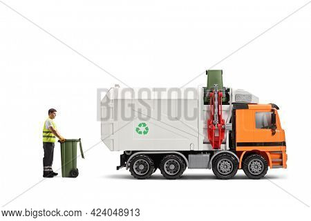 Full length profile shot of a waste collector with a bin standing behind a garbage truck isolated on white background