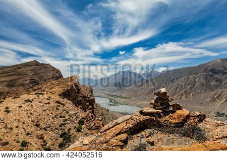 View of Spiti valley in Himalayas with stone cairn. Spiti valley, Himachal Pradesh, India