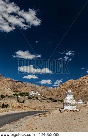 Whitewashed chortens Buddhist stupas near Likir monastery. Ladakh, India