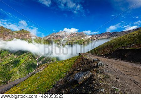 Road in Himalayas. Ascend to Rohtang La pass from Kullu valley, Himachal Pradesh, India