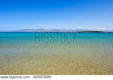 Santa Maria Beach With Golden Sand, Emerald Waters And View On The Island Of Naxos. The Best Beach O