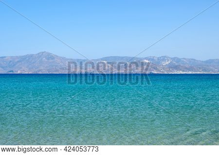 Santa Maria Beach With Emerald Waters And View On The Island Of Naxos. The Best Beach Of Paros. Cycl