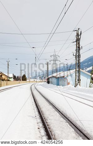 Snow Covered Railway Track.  The View Along A Snow Covered Railway Track From Bruck - Fusch Station