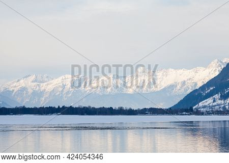 Lake Zell.  The View From The Austrian Town Of Zell Am See Across Lake Zell Towards A Winter Landsca