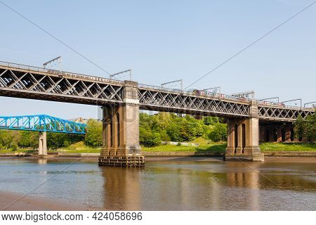 Gateshead, England - May 21:  The King Edward Vii Bridge Over The River Tyne On May 21, 2018.  A Tra