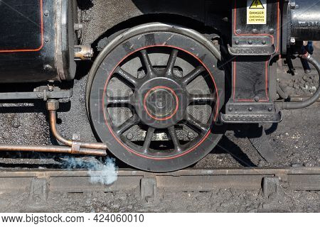 Steam Train Leading Wheel.  A Close Up Of The Leading Wheel On A Steam Train.