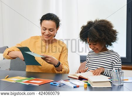 Professional Childs Psychologist Working With An Autistic Girl Child Uses Psychological Session. Art