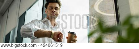 Young Businessman Looking At Wristwatch While Holding Coffee To Go, Banner