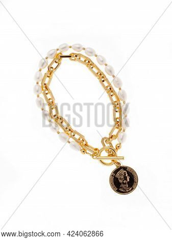Luxury Elegant Golden Pendant With Baroque Pearl And Golden Chain Bracelet Isolated On  White Backgr