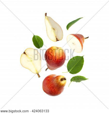 Flying Red Ripe Juicy Pear And Green Leaves Isolated On White Background. Sweet Whole Pears And Slic