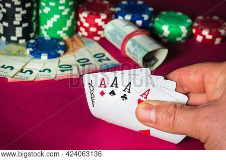 Poker Cards With Five Of A Kind Combination. Close Up Of Gambler Hand Takes Playing Cards In Casino.