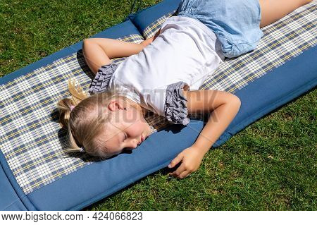 Cute Adorable Caucasian Little School Girl Napping And Daydreaming Sleep Lying On Matress Mat Over G