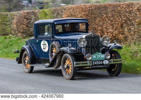 Southwaite, England - April 5:  A 1931 Hupmobile S Coupe Climbs Southwaite Hill In Cumbria On April