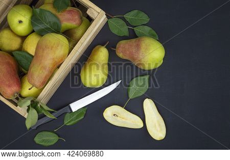 Autumn Background. Ripe Pears With Leaves In A Wooden Box. Top View. Flat Lay.fresh Organic Pears. F