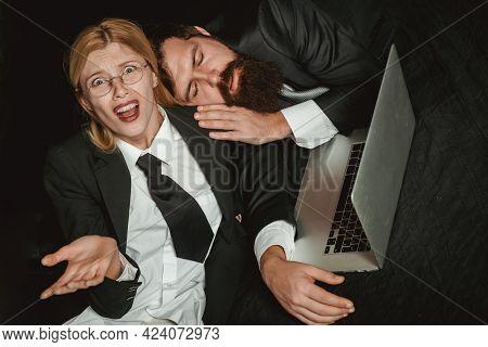 Tired, Overworked Business Couple. Tired Businessman Sleeping In Dark Office. Man Sleeping At Workin