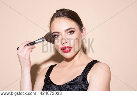 Beautiful Young Woman With Clean Fresh Skin Holding Makeup Brush. Applying Tone To Skin.