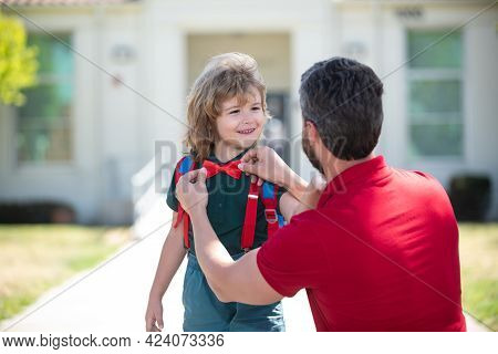 Father Helping Son Ready To School. Father Supports And Motivates Son. Kid Going To Primary School.