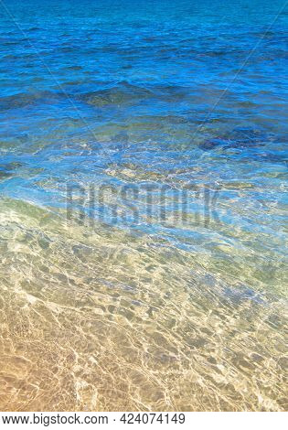 Sea Abstract Or Rippled Water Texture Background. Calm Water Surface Texture With Splashes And Waves