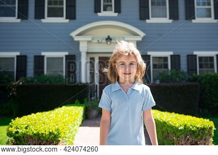 Portrait Of A Cute Child Boy Outdoor Home, Near House. Close Up Caucasian Kids Face. Closeup Head Of