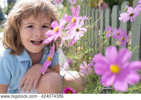 Portrait Of A Cute Child Boy With Spring Flowers. Close Up Caucasian Kids Face. Closeup Head Of Funn
