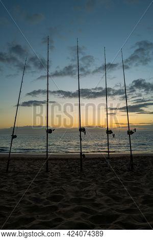 Sea Fishing On Sunny Day Trolling Rod Reels Wake Ocean.