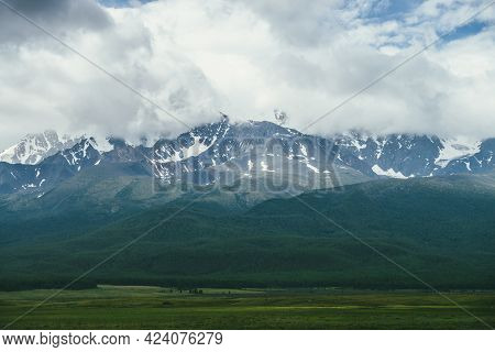 Dramatic Mountains Landscape With Snowy Mountain Range Among Low Clouds. Atmospheric Highland Scener