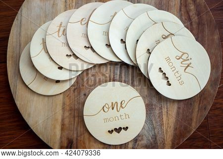 collection of wooden milestone disks