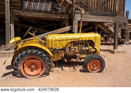 Goldfield, Arizona - May 9, 2021: The Broken Down Vintage Tractor, In The Tourist Trap Goldfield Gho