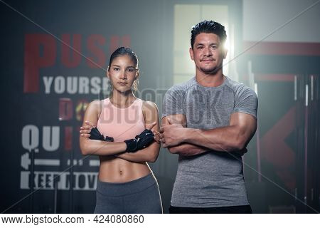 Portrait Of Active Athlete Man And Woman With Six Packs Abs In Sportswear Standing And Crossing Arms