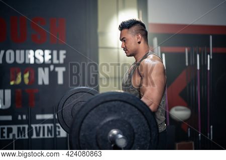 Asian Active Sportsman Workout, Exercise To Maintain Muscle And Biceps In Gym Club. Athlete Bodybuil