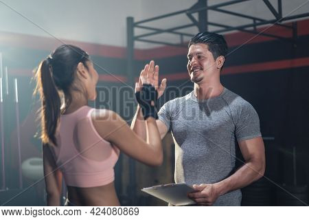 Active Sport Athlete Man And Woman With Six Pack Abs Friend In Sportswear Greeting By Give High Five