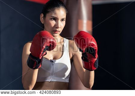 Portrait Of Asian Beautiful Female Athlete Or Sportswoman In Sportswear And Boxing Gloves. Young Act