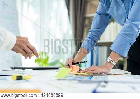 Close Up Hands Of Businesspeople Working In Office, Write On Paperwork And Prepare Document Plan On