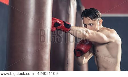 Caucasian Bodybuilder Man Shirtless Athlete Wear Boxing Gloves, Doing Workout Exercise By Hitting A