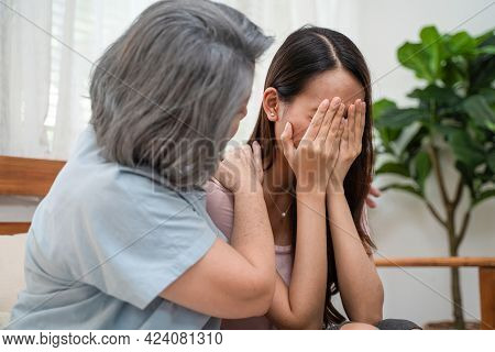 Asian Loving Elderly Mother Consoling And Comforting Upset Depressed Young Girl Daughter Crying For