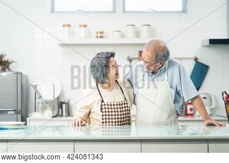 Aged, Apron, Asian, Cheerful, Cook, Counter, Couple, Dish, Domestic, Elder, Elderly, Enjoy, Family,