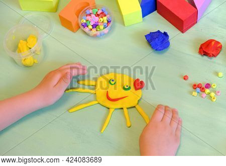 Child Playing With Plasticine, Colorful Modeling Clay And Sculpting Funny Sun . Home Education Game