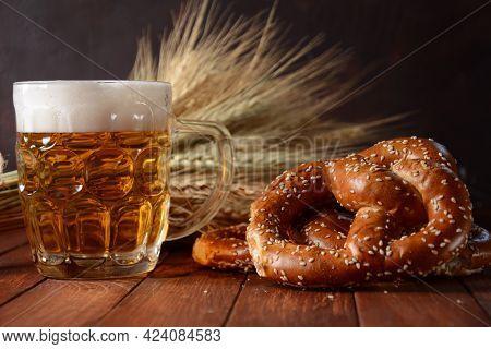 Bavarian Freshly Baked  Homemade Soft Pretzel With Beer. Rustic Style. Oktoberfest