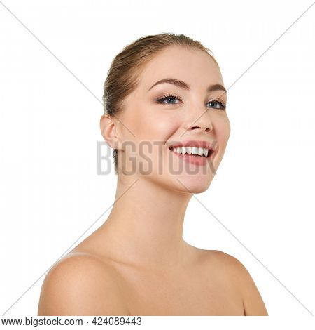 Young attractive woman posing at studio and happy smiling over white background. Beautiful girl with perfect smile.