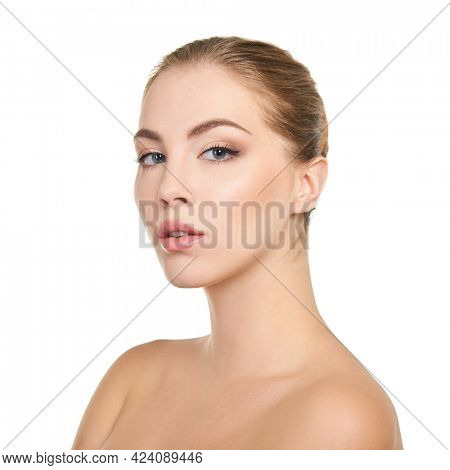 Young attractive woman with perfect make-up posing at studio over white background, beauty female portrait.