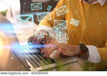 Businessman Sending Emails At Table Indoors, Closeup