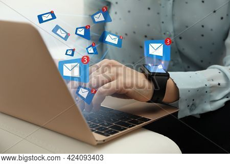 Woman Sending Emails At Table Indoors, Closeup