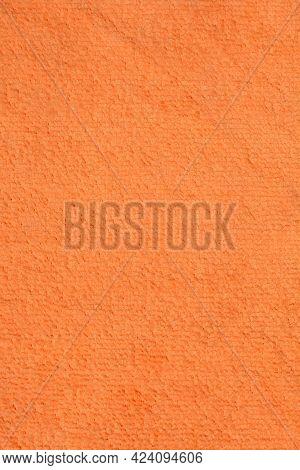 Detail Of An Orange Microfiber Cloth Texture