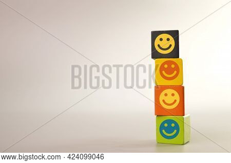 Wooden Blocks With Happy Face Symbols. Customer Evaluation And Satisfaction Concept.