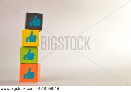 Wooden Blocks With Like Symbols. Customer Evaluation And Satisfaction Concept.